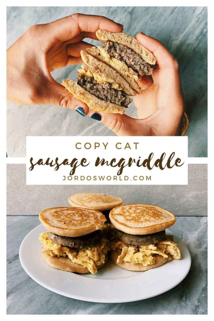 This is a pinterest picture for the copy cat sausage mcgriddle recipe. There are 3 sausage mcgriddles on a white plate with a marbled background. The mcgriddles are sandwiches made with pancakes, sausages, and eggs. There is also a pair of hands holding the mcgriddle and it is cut in layers so you can see all of the pancakes, eggs, and sausages.