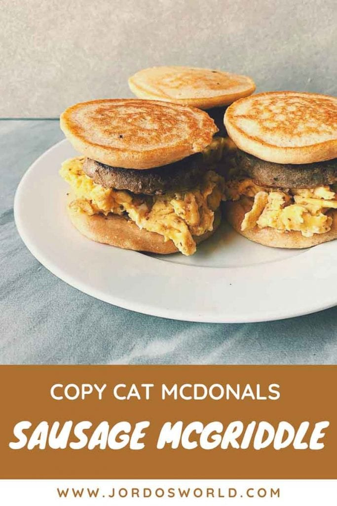 This is a pinterest picture for the copy cat sausage mcgriddle recipe. There are 3 sausage mcgriddles on a white plate with a marbled background. The mcgriddles are sandwiches made with pancakes, sausages, and eggs.