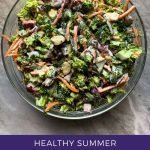 """This is a pinterest picture for a healthy summer broccoli salad recipe. There is a large glass bowl filled with the ingredients for the salad recipe. There is broccoli, red onions, almonds, cilantro, dried cranberries, and shredded carrots in the large bowl. These ingredients are all mixed together in a white sauce. The title of the recipe, """"Healthy Summer Broccoli Salad"""" is at the bottom of the picture."""