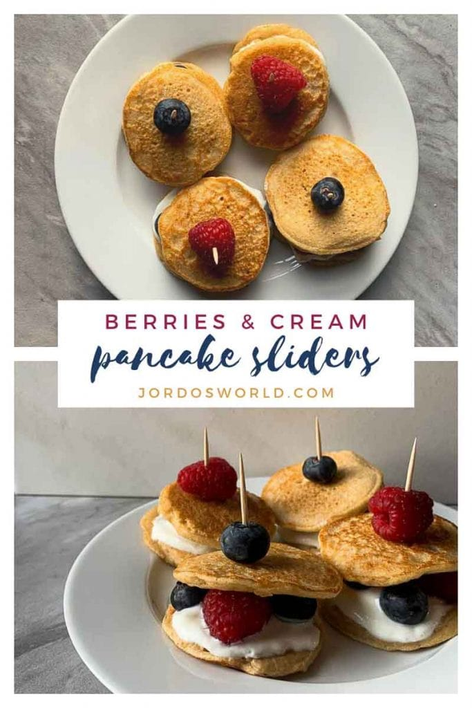 """This is a pinterest picture for the berries and cream pancake sliders recipe. There is a small white plate that has four pancake sliders. The pancake sliders are pancake sandwiches made up of a layer of pancake, vanilla greek yogurt, and berries topped with another pancake. These are held together with a toothpick and a berry on top of that. One of the pictures shows the top-down view of the sliders and the other picture shows the front-view of the sliders. The middle of the picture has the title of the recipe, """"Berries and Cream Pancake Sliders""""."""