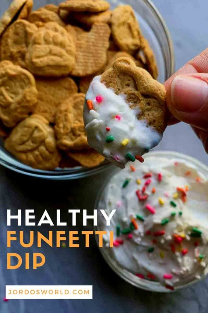 Pinterest image with a cookie being dipped into funfetti dip. Healthy funfetti dip in bottom left corner.