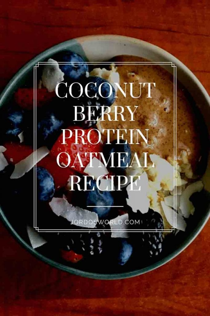 """Pinterest image of a bowl of oatmeal topped with mixed berries, peanut butter, and coconut shavings. Superimposed text reads """"coconut berry protein oatmeal recipe."""""""