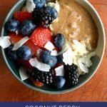 """Pinterest image of a bowl of oatmeal topped with mixed berries, peanut butter, and coconut shavings. Superimposed text reads """"coconut berry protein oatmeal"""""""