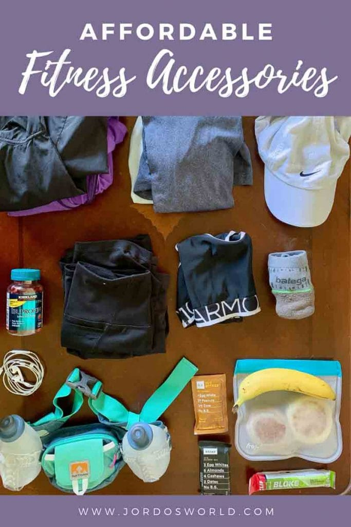"""This is a pin for my affordable fitness accessories post. There is a table with a water bottle, clothes, and snacks. The title of the post, """"Affordable Fitness Accessories"""" is across the top of the post."""