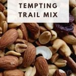 This is a pin for the Copy Cat Trader Joe's Tempting Trail Mix recipe. There is a picture of trail mix with nuts, dried fruit and chocolate. The title of the post, Tempting Trail Mix, at the top of the post.