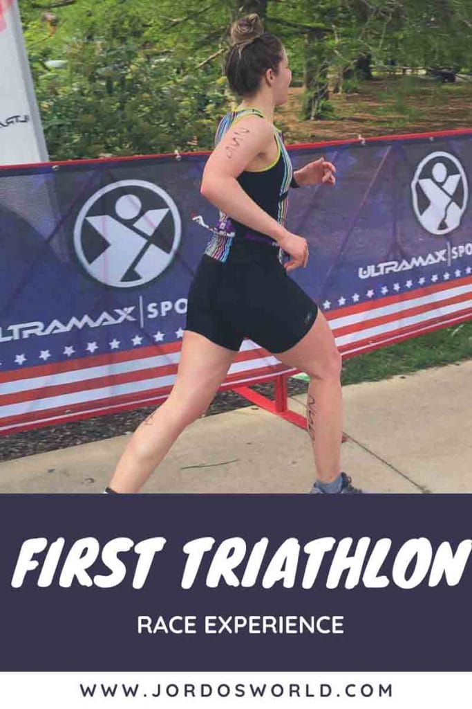 This is a pin for my first half triathlon race. It has a girl running across a finish line with a race number, with the title of the post across the picture.