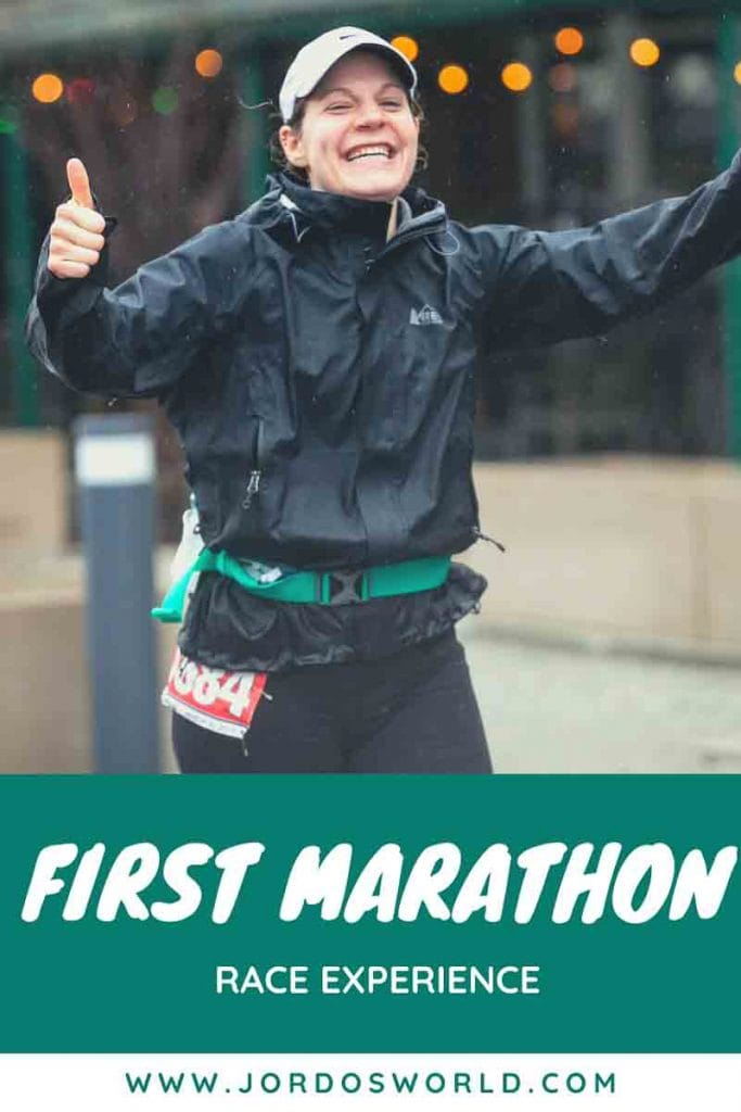"This is a pin for my first marathon race. It has a girl wearing black shorts, a black coat, a race number and a white hat while she is running in the rain. The title of the post, ""How I Ran My First Marathon"" across the top of the picture."