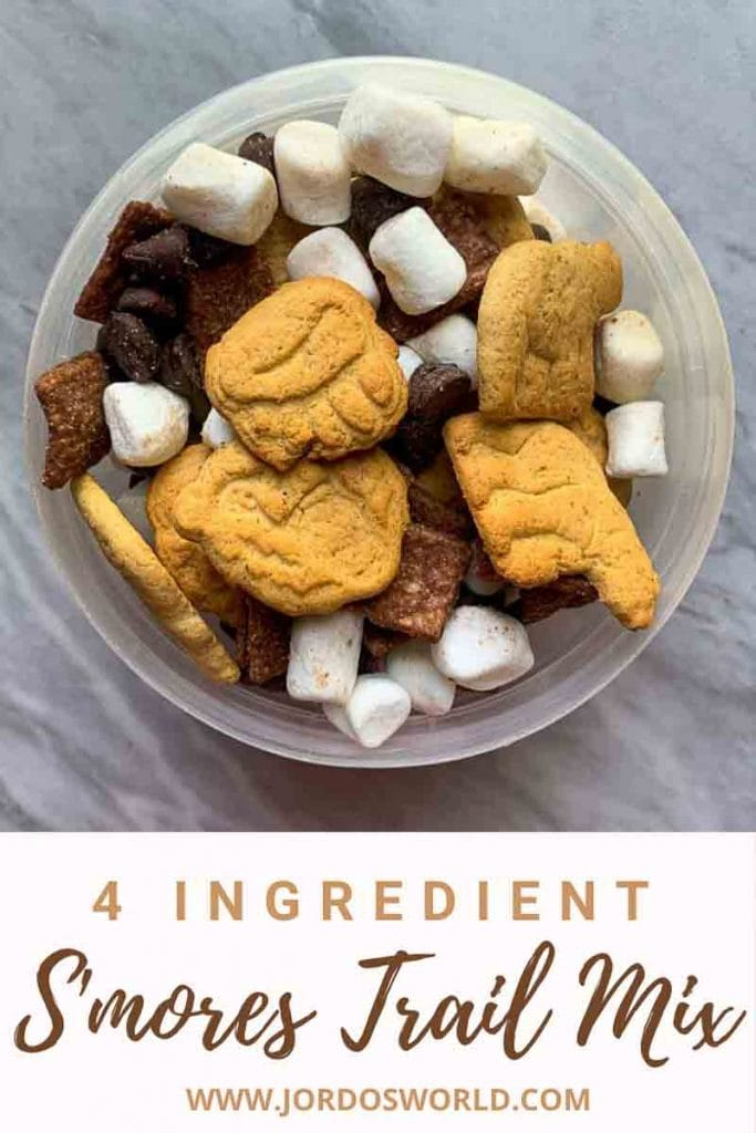 This is a pin for a S'mores Trail Mix recipe. There is a small container of trail mix with the title of the recipe across the bottom of the image.