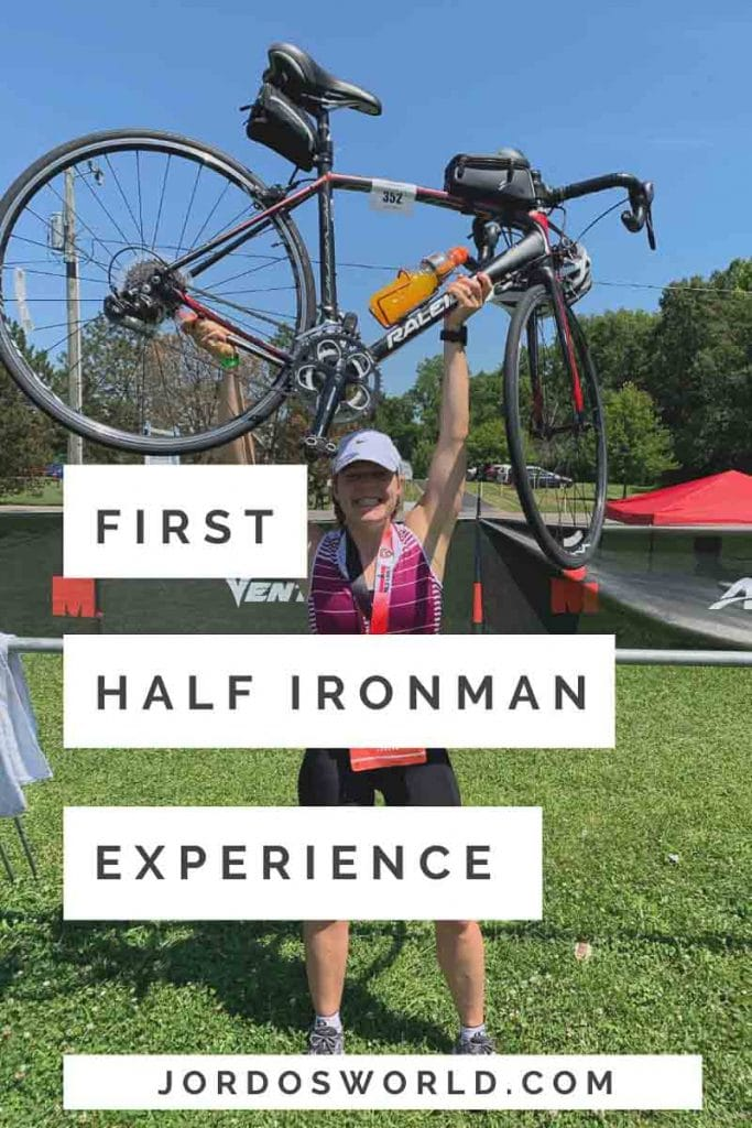 This is a pin for my first half ironman race. It has a girl holding a bike over her head wearing a race number, with the title of the post across the picture.