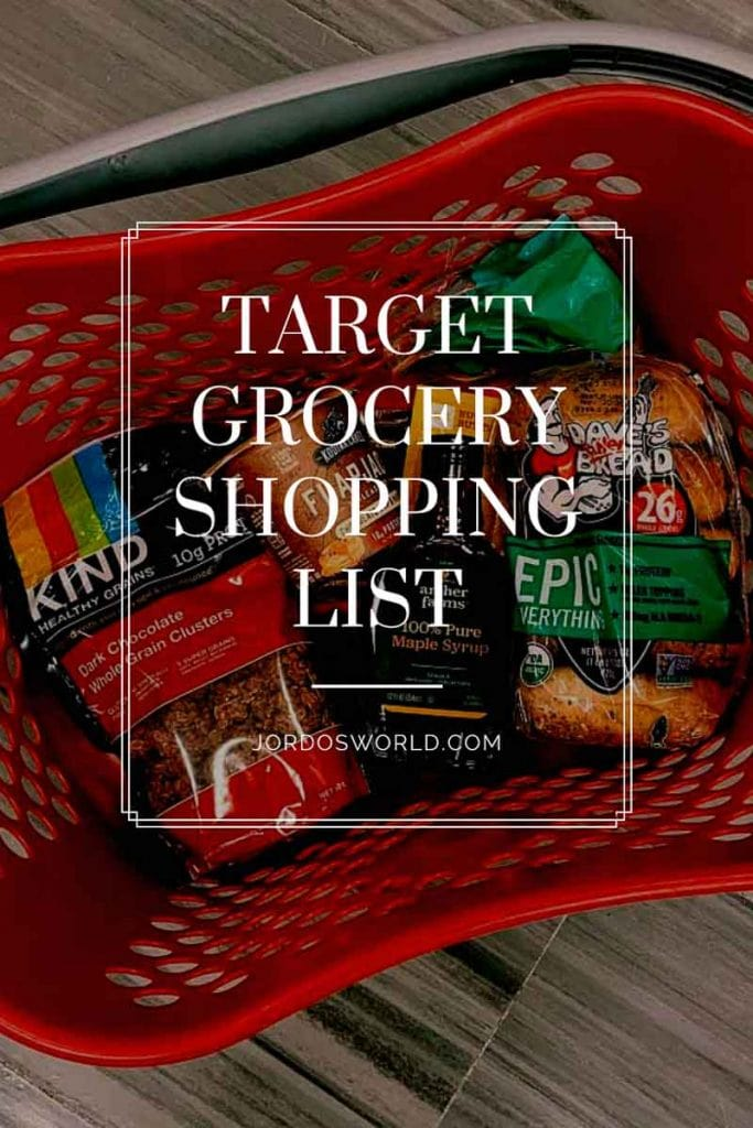 "This is a pinterest picture for a target grocery shopping list. There is a red target shopping basket with a grey handle. In the shopping basket are healthy finds from target. The title of the post, ""Target Grocery Shopping List"" is also on the image."