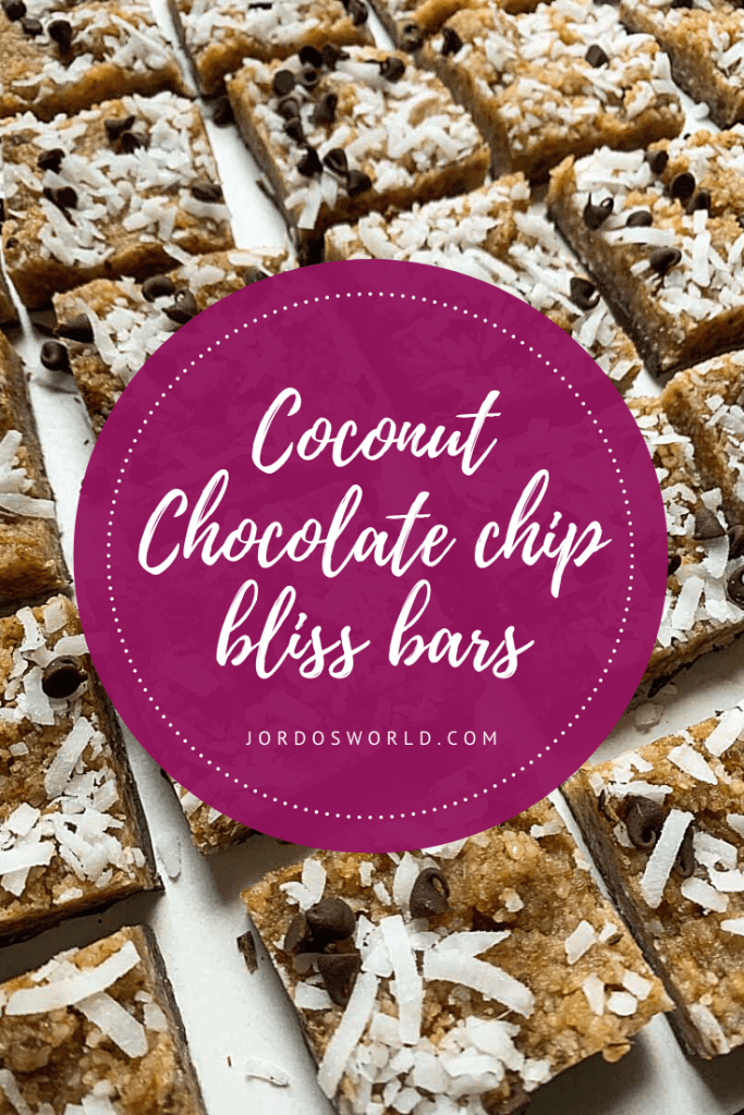 This is a pinterest pin for the coconut chocolate chip bliss bars. There are square chewy bars topped with shredded coconut and mini chocolate chips.