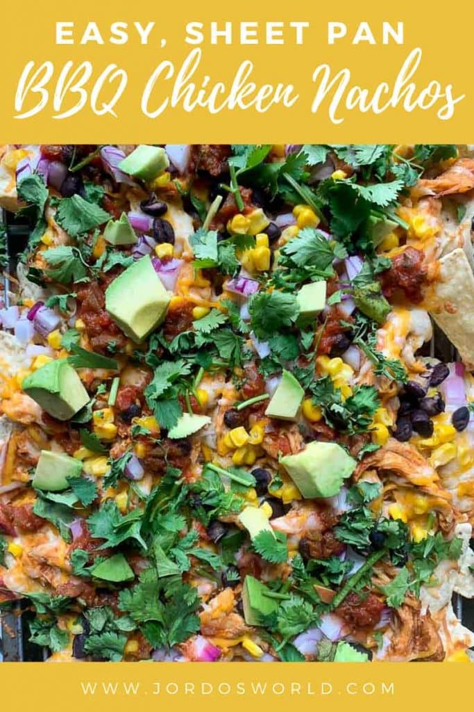 This is a pinterest pin of sheet pan BBQ chicken nachos. On the nachos is shredded bbq chicken, black beans, corn, cilantro, red onions, and cheese. There is also the title of the recipe on the pin.