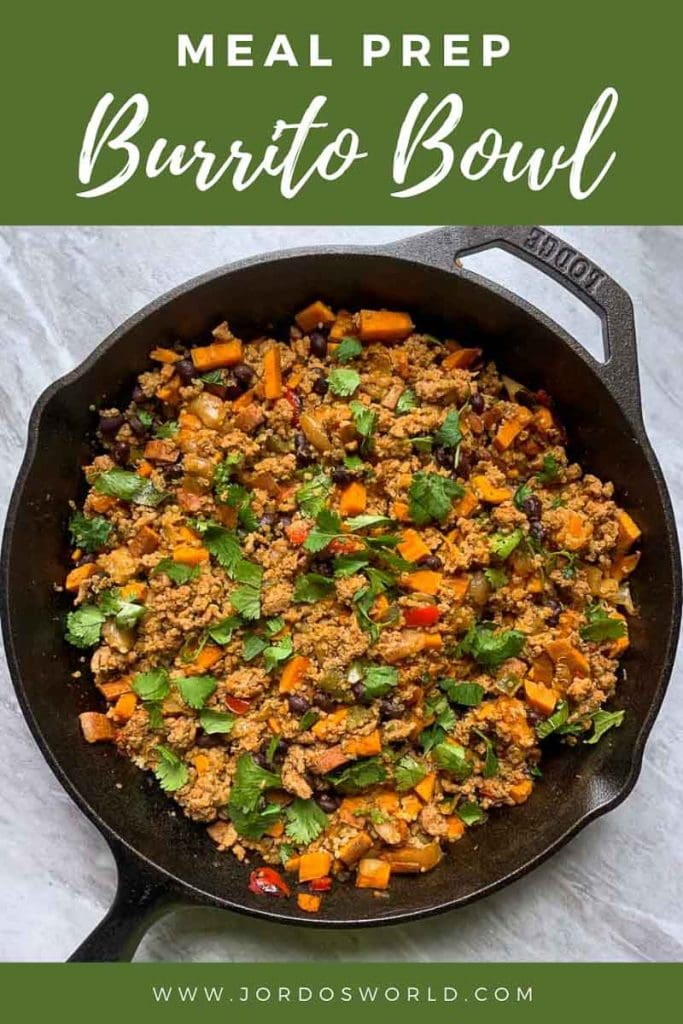 This is a pinterest pin for the meal prep burrito bowl recipe. There is a cast-iron skillet with the burrito bowl in it. The burrito bowl is ground turkey, sweet potatoes, black beans, peppers, onions, and cilantro all mixed together.