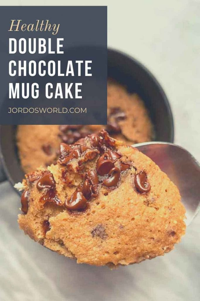 This is a pinterest pin for a healthy double chocolate mug cake. There is a picture of a mug cake topped with chocolate chips. There is also a spoon full of mug cake and chocolate chips being held up. The title of the recipe is also on the picture.