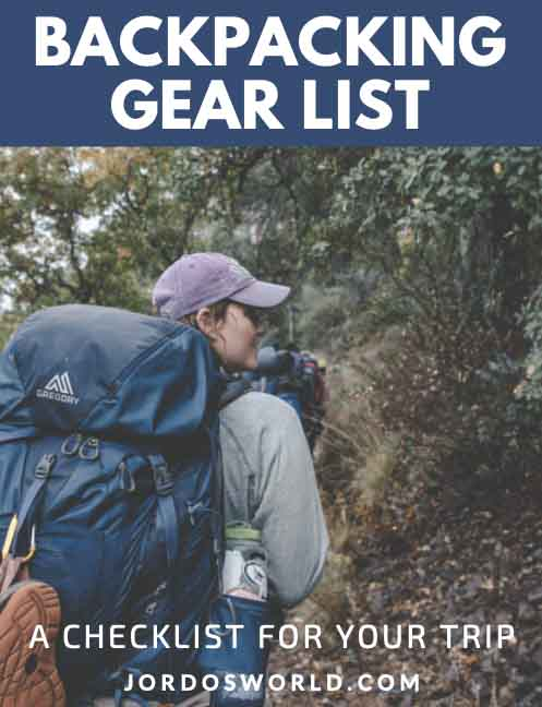 This is a pinterest pin for the backpacking gear list post. There's a girl standing with a backpack on looking at trees and the title of the post on the picture.