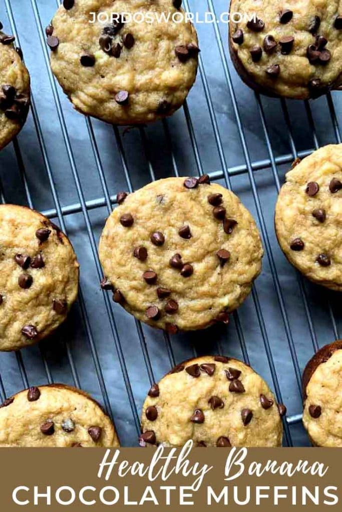 This is a pinterest pin for healthy banana chocolate chip muffins. There is a wire rack with circle muffins covered in mini chocolate chips.