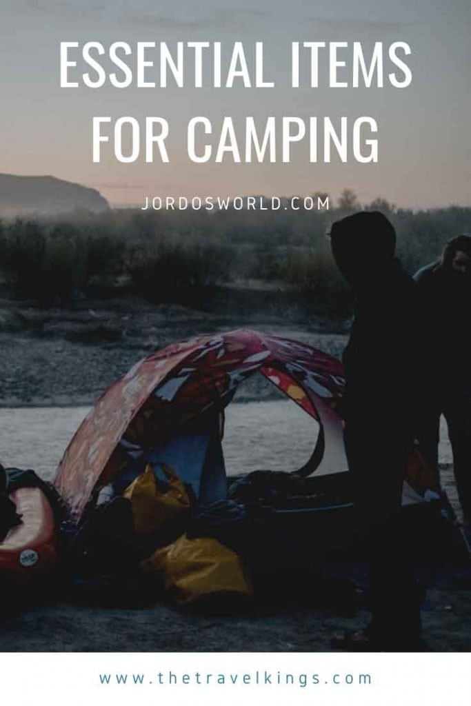 This is a pinterest pin for a camping gear list. There is a tent with camping gear next to it with a sunrise behind it. The title of the post is also on the pin.