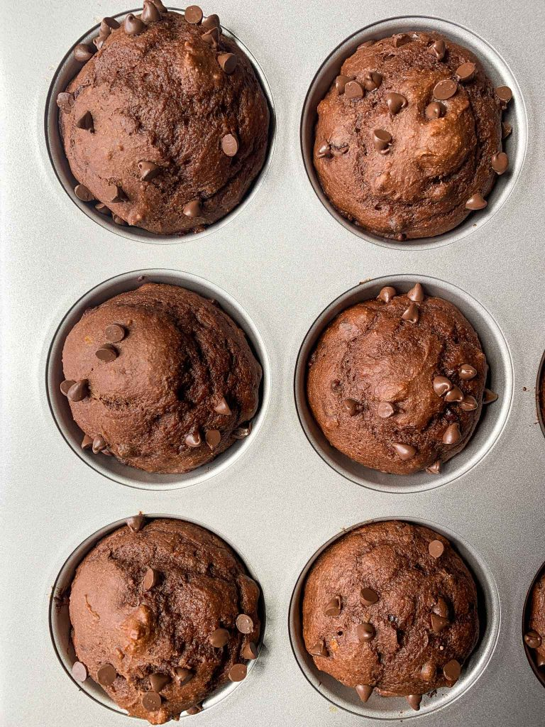 This is a picture of the chocolate banana muffins. These are the muffins in the muffin tin, right after they are finished baking.