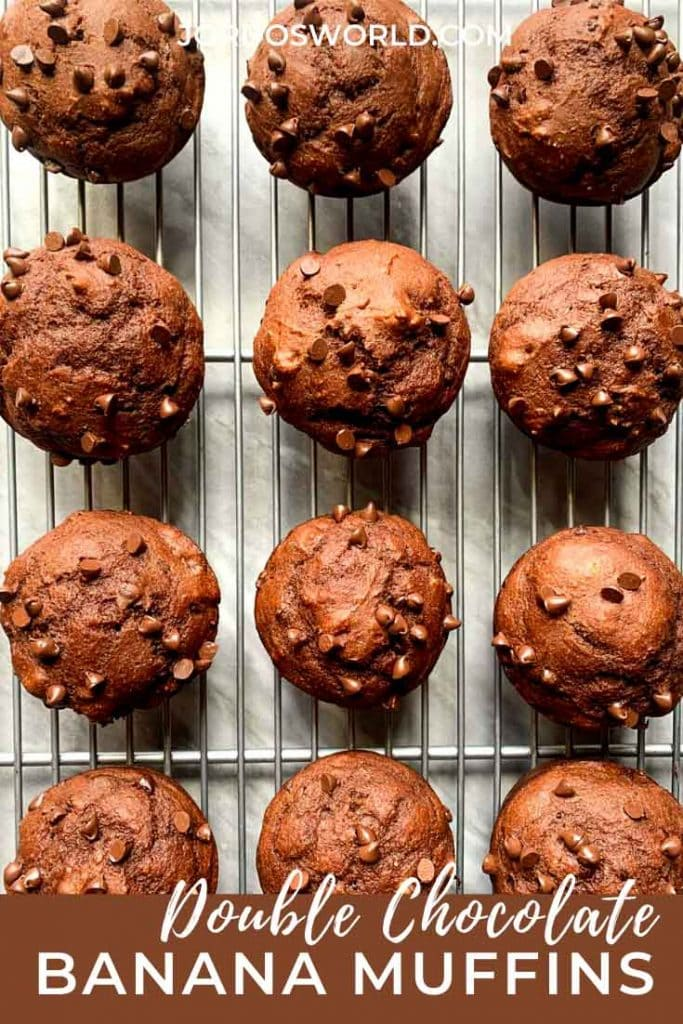 This is a pinterest pin for double chocolate muffins. There is a silver cooling rack topped with chocolate muffins with mini chocolate chips.