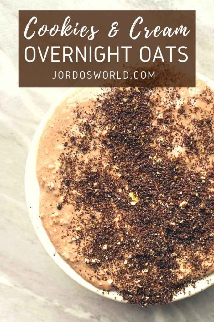 This is a bowl of cookies and cream overnight oats. There is a bowl filled with light brown, chocolate oats topped with crushed oreos.