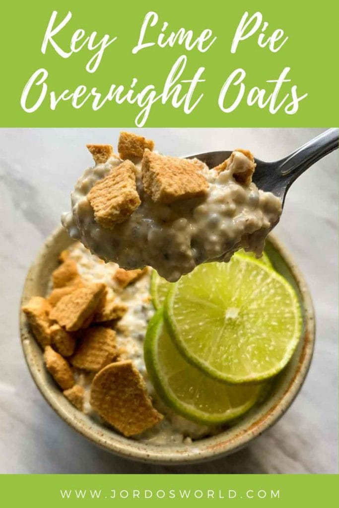 This is a pinterest pin for key lime pie overnight oats. There is a small bowl filled with oats and topped with crushed honey grahams and limes. A spoon is holding up a bite of the oats.