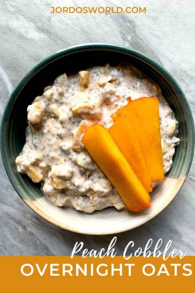 This is a pinterest pin for peach cobble overnight oats. There is bowl filled with oats with chunks of peach and graham crackers, as well as slices of peaches on top.