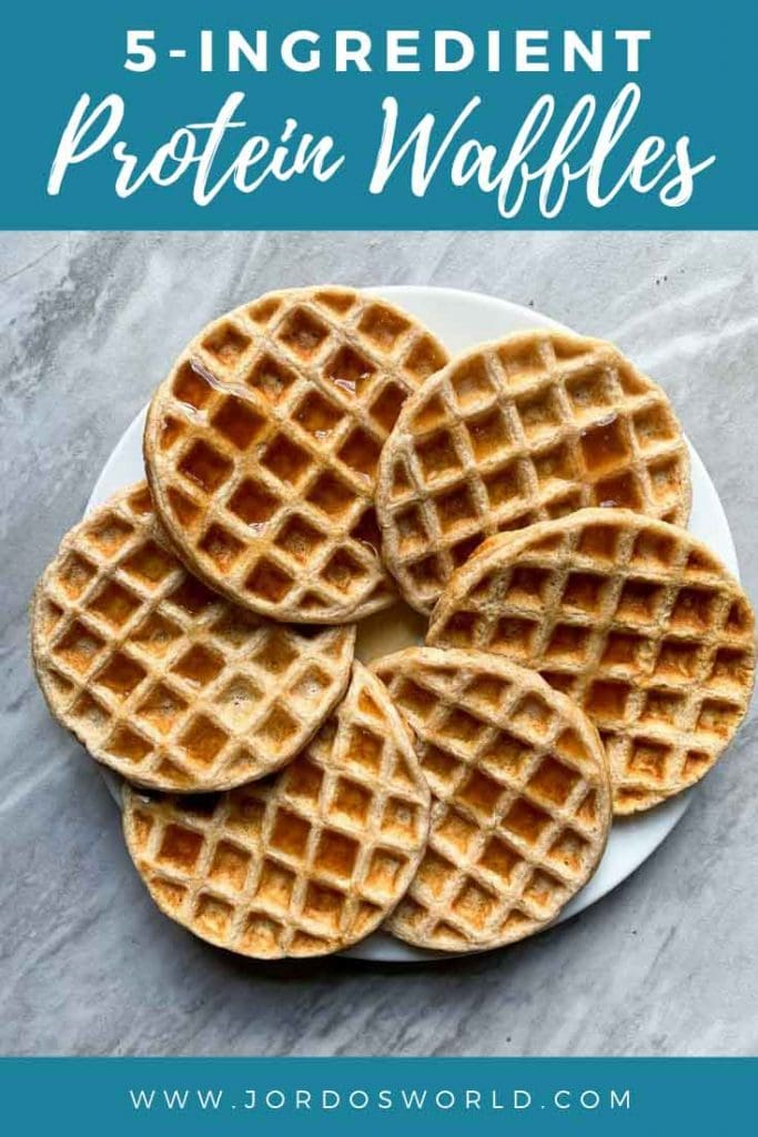 This is a pinterest pin for protein waffles. There is a plate filled with crispy, warm protein waffles.