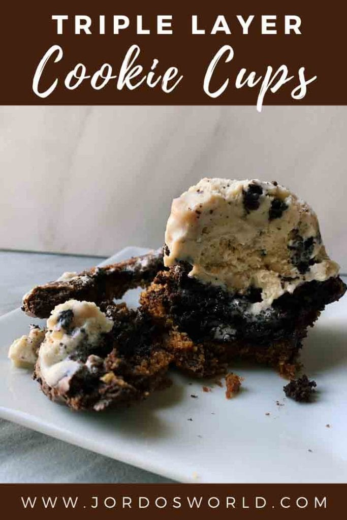 This is a pinterest pin for the triple layer cookie cups. There is a layer of cookie, oreo, brownie, and a scoop of ice cream on top. This cookie cup is cut down the middle so you can see the layers.