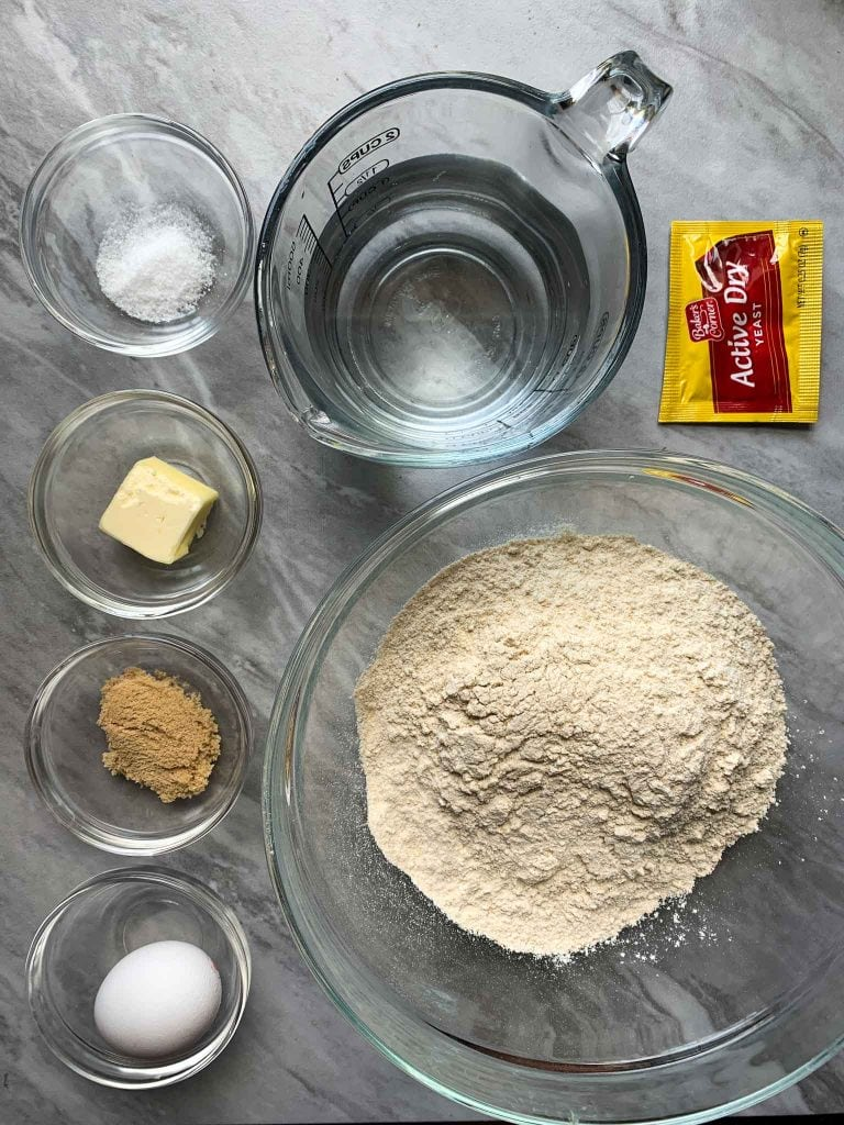 These are all of the ingredients for the pretzel bites. There are bowls of salt, butter, brown sugar, and egg. There is also water, active yeast, and kodiak cakes mix.