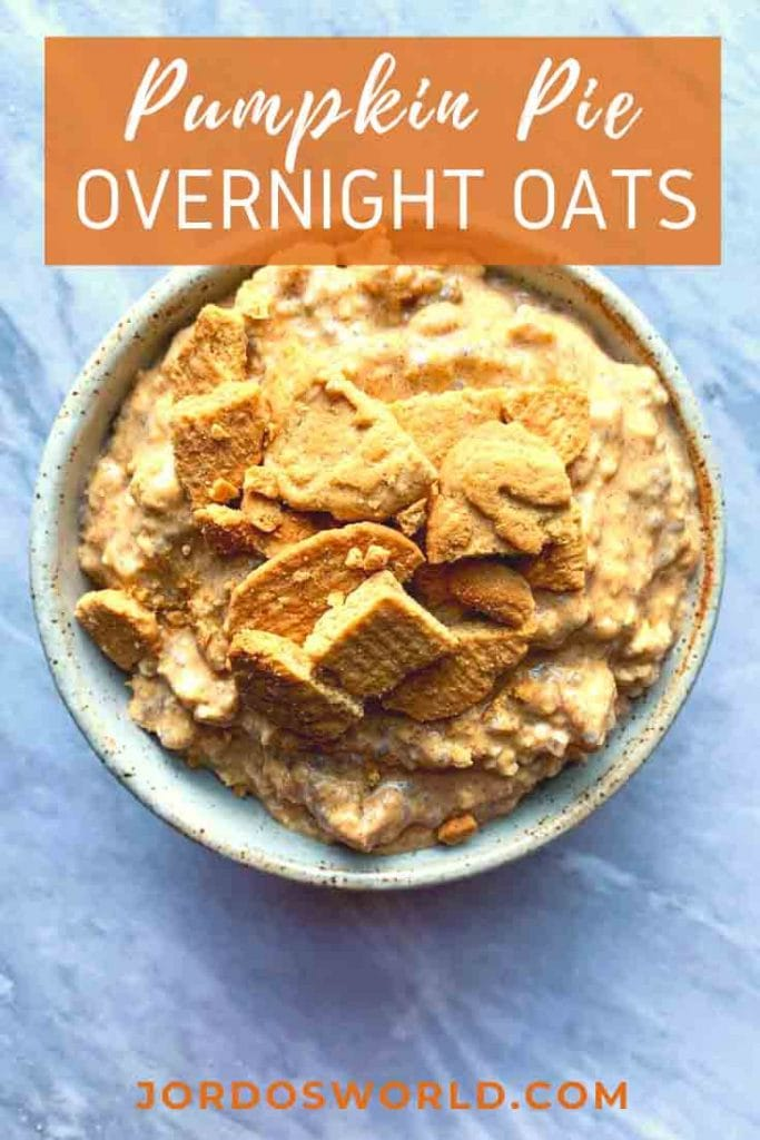 This is a pinterest pin for pumpkin pie overnight oats. There is a ceramic bowl of pumpkin pie overnight oats and topped with crushed bear bites.
