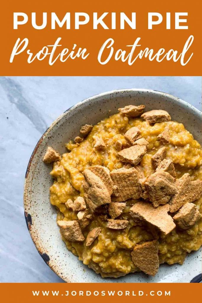 This is a pinterest pin for pumpkin pie protein oatmeal. This is a bowl of pumpkin protein oatmeal. There is creamy, light orange oatmeal topped with chunks of crushed graham crackers.