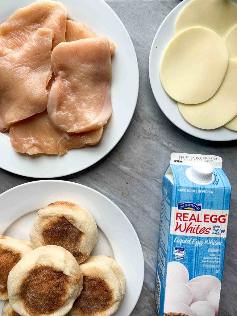 These are the ingredients for the copy cat chick-fil-a egg white grill sandwich. There are english muffins, egg whites, chicken breasts, and slices of cheese.