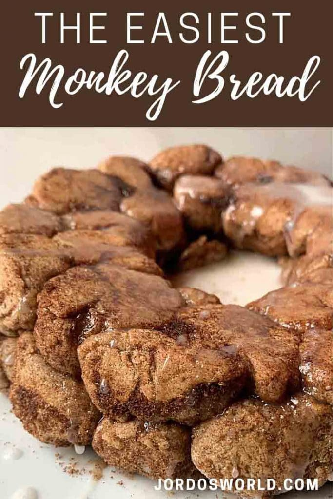 This is a pinterest pin for easy monkey bread. There is a close-up picture of a half ring of monkey bread that is light brown, covered in cinnamon, and drizzled in icing.