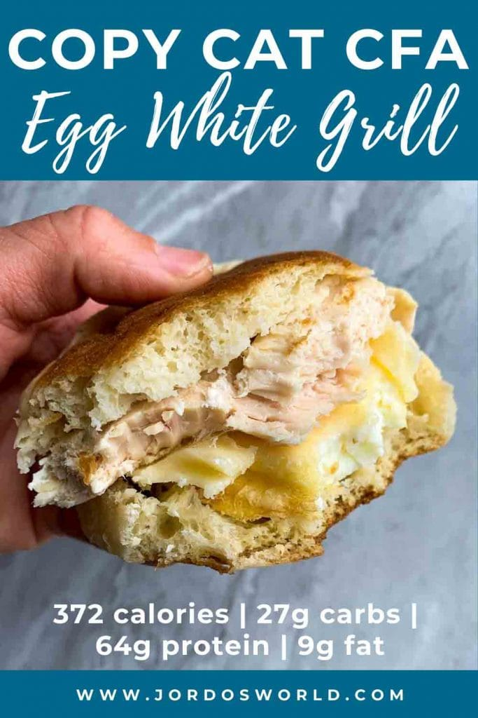 This is a pinterest pin for a copy cat chick-fil-a egg white grill. There is a hand holding a breakfast sandwich with a bite out of it. The sandwich has an english muffin, cheese, egg white patty, and chicken breast.
