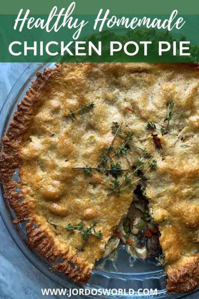 This is a pinterest pin for healthy chicken pot pie. There is a pie dish filled with a chicken and vegetable filling and brown flaky crust. There is a piece cut out of the pie and thyme sprinkled on top.