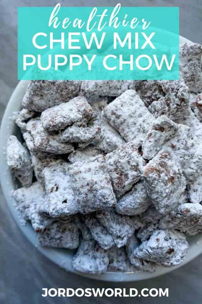 This is a pinterest pin for healthy puppy chow. There is a white bowl filled with chex cereal covered in chocolate and peanut butter coating and white powdered sugar.