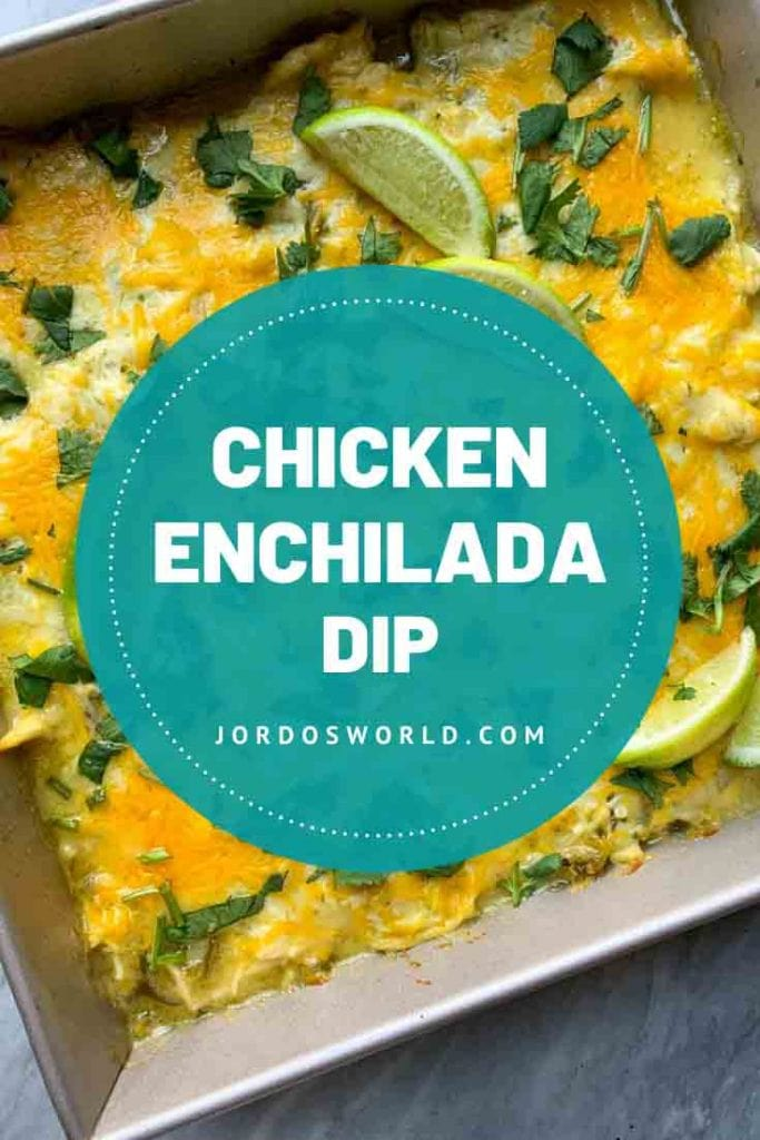 This is a pinterest pin for chicken enchilada dip. There is a pan filed with chicken and cheese dip, topped with limes and cilantro.
