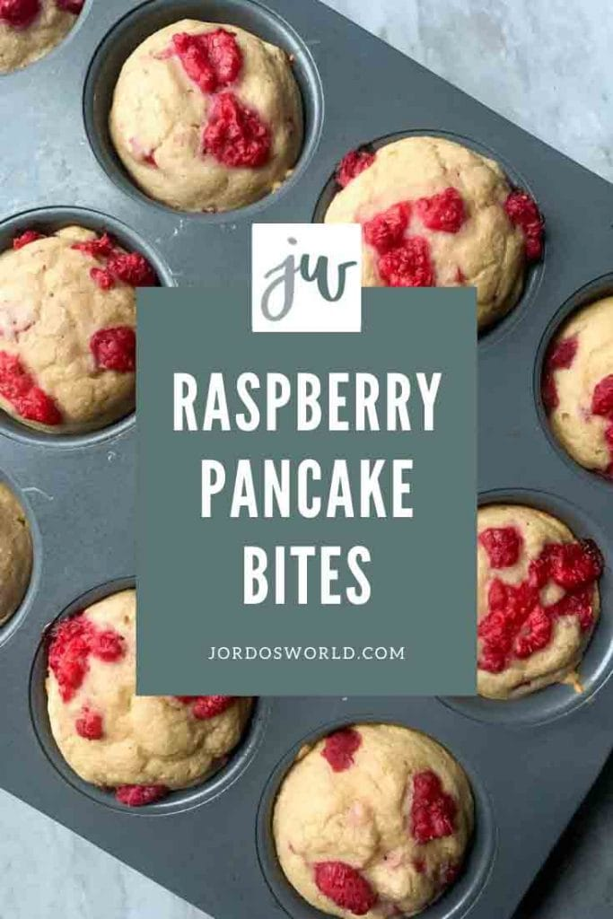 This is a pinterest pin for raspberry pancake bites. There is a muffin tin filled with pancake bites topped with red reaspeberries.
