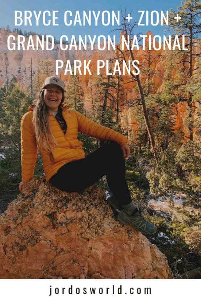 This is a pinterest pin for the national parks trip post. There is a girl with black leggings and a yellow coat sitting on a rock with a hat on.