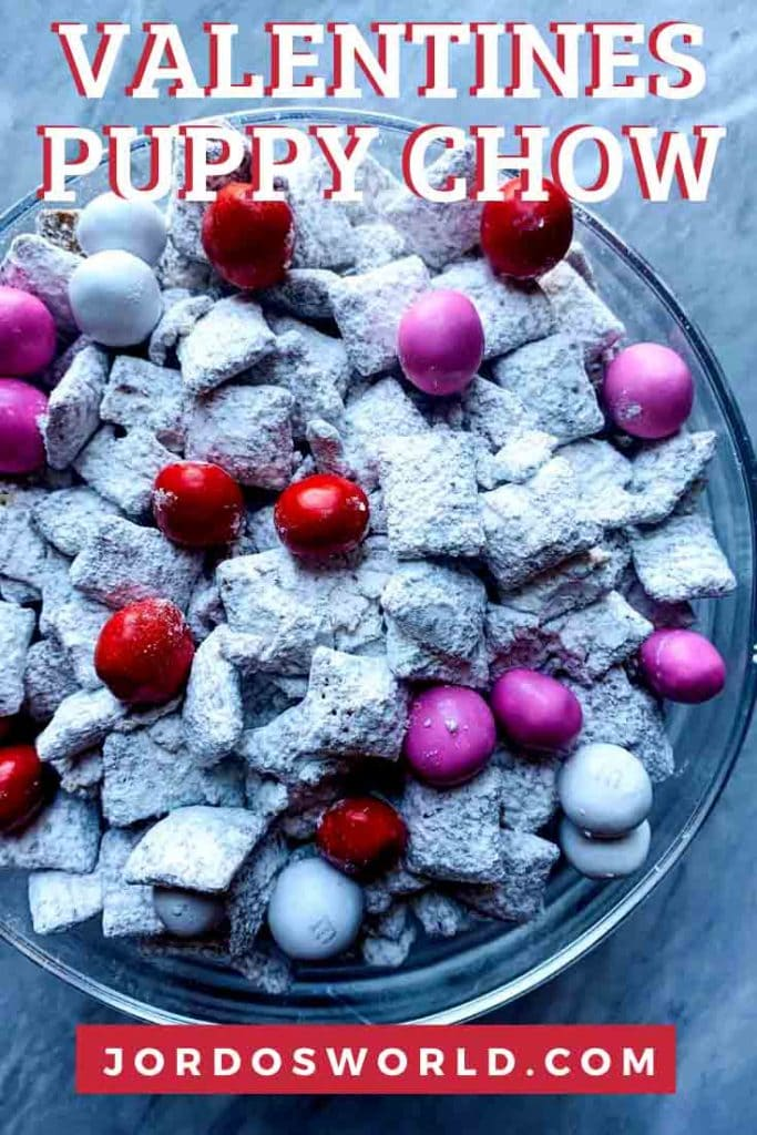 This is a bowl of valentines puppy show. There is powdered sugar white chex mix with valentins m&m's mixed in.