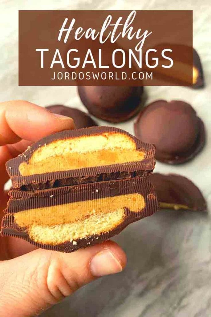 These are copy cat tagalongs. There is a chocolate layer covering a wafer and peanut butter layer. The tagalong is cut in half and held up in a hand so you can see the layers.
