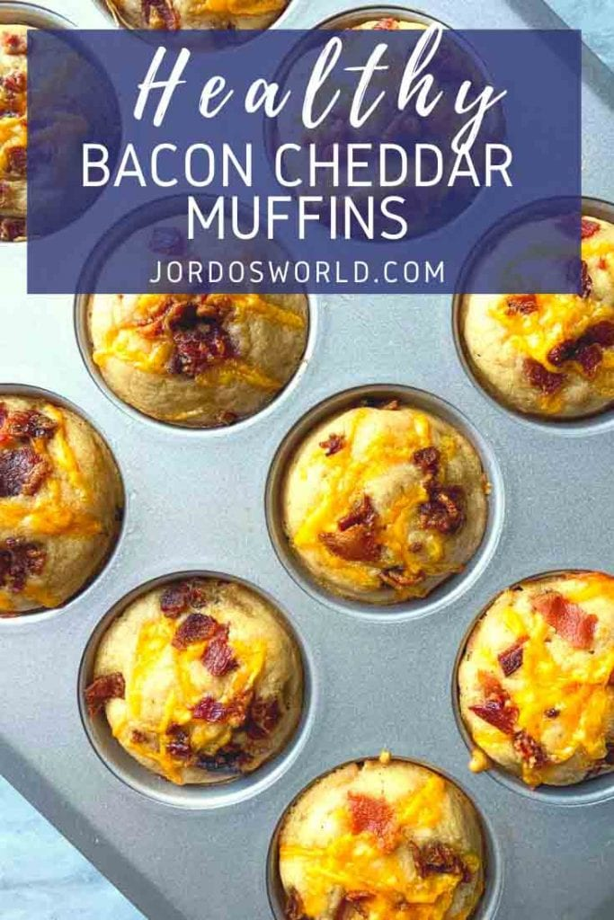 This is a tin full of bacon cheddar muffins. There are muffins topped with bits of bacon and melted cheddar cheese.
