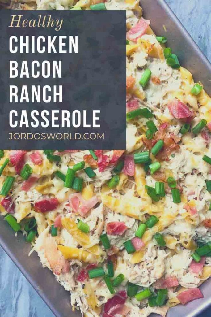 This is a pinterest pin for chicken bacon ranch casserole. There are pasta noodles topped with pieces of bacon, melted cheese, and green onion.