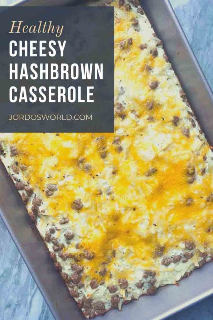 This is a pinterest pin for healthy hashbrown casserole. There is a pan with hashbrowns, egg whites, pieces of turkey sausage, and melted cheese.