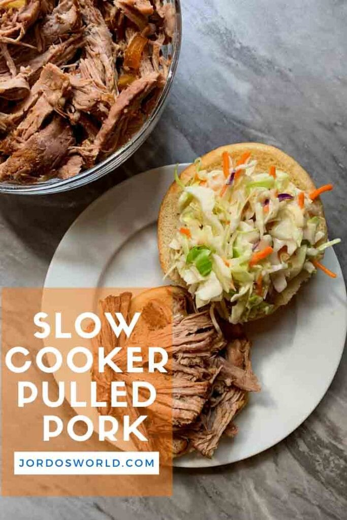 This is a Pinterest pin for slow cooker bbq pulled pork. There is an open-faced sandwich with coleslaw on one side and pulled pork on the other.