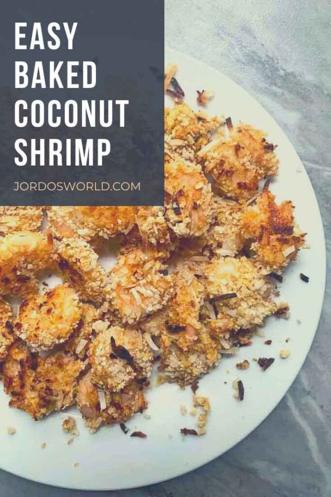 This is a pinterest pin for baked coconut shrimp. There is a plate with several pieces of shrimp on it.