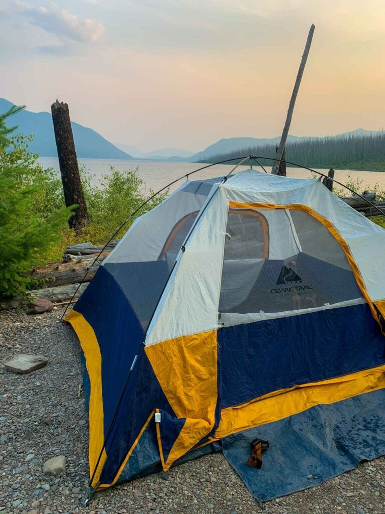 This is a picture of a big tent in front of McDonald Lake at sunset in glacier national park.