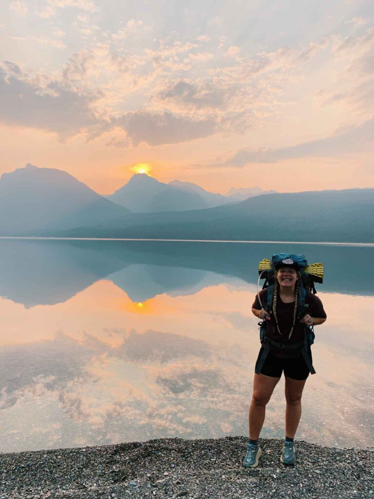This is a picture at sunrise in McDonald lake in glacier national park.